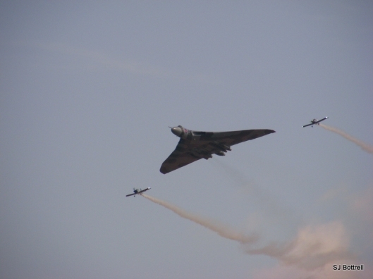 The only flying example of the Vulcan Bomber with two stunt planes