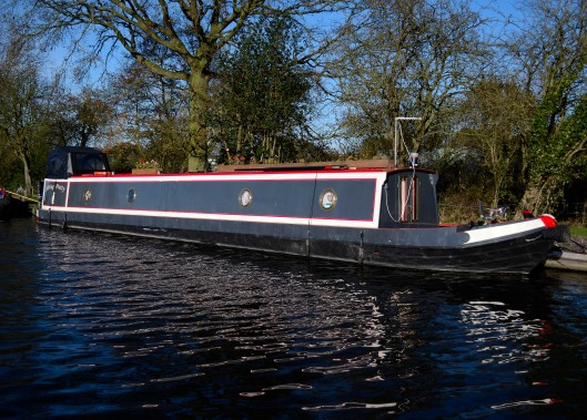 Narrowboat named Sitting Pretty moored near Otherton Marina on the Staffs & Worcs Canal.
